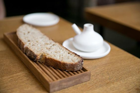 Homemade sourdough bread with olive oil at Relæ Copenhagen by cityfoodsters