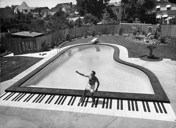 Loomis Dean—Time & Life Pictures/Getty Images.  Pianist Liberace has a full 88 keys to dance on at the grand piano-shaped pool in his California backyard in 1954.