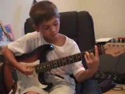 Little Kid Rocks Zeppelin On The Guitar Video.flv