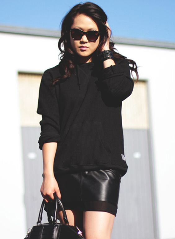 sporty hoodie with leather skirt.     www.theversastyle.com
