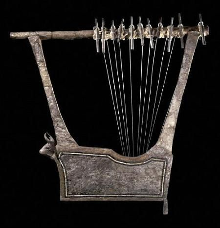 Silver Lyre:. This is one of the two silver lyres found in The Great Pit. They were both made of wood, covered in sheet silver attached with small silver nails. The eleven silver tubes acted as tuning pegs.