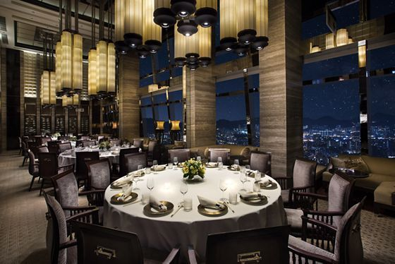 Dining Room With Wall Of Windows Round Tables With Chairs And Modern Chandeliers Hong Kong Hotels Luxury Hotel Private Dining Room