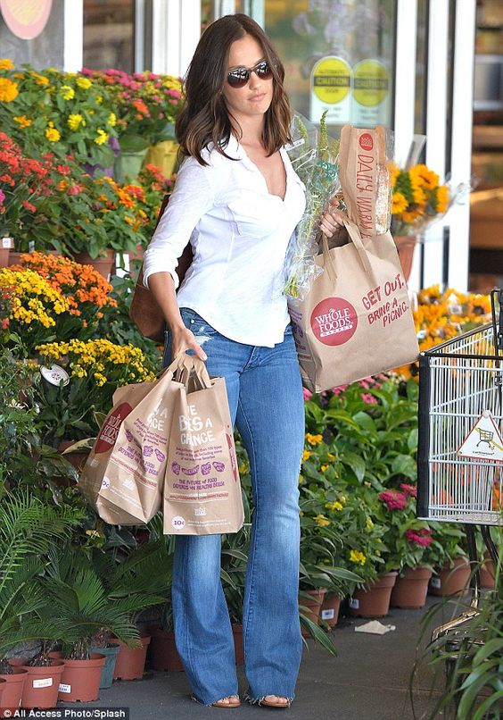 Stocking up: The 34-year-old actress was pictured shopping at Whole Foods and left carryin...