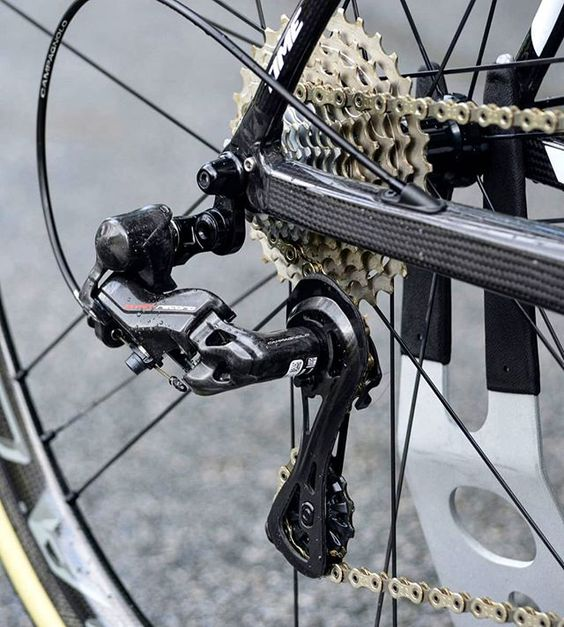The Campagnolo 12 Speed rear derailleur has a longer body and pulley cage in order to engage more cassette teeth for better efficiency, accurate shifting, and reduced wear on the drivetrain. #campagnolo #campagnolo12speed #cycling #cyclingshots