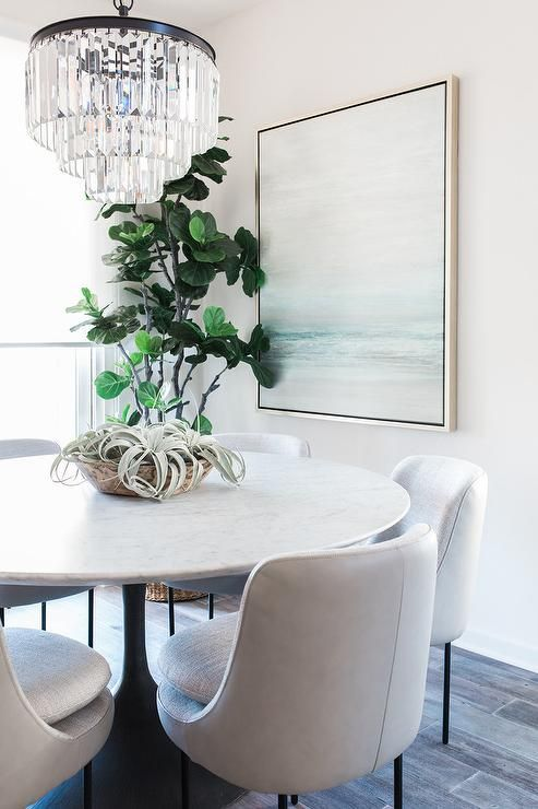 Elegant Dining Room Featuring A Restoration Hardware 1920s Odeon Clear Glass Fringe 3 Tier C Round Dining Room Table Tulip Dining Table Marble Top Dining Table