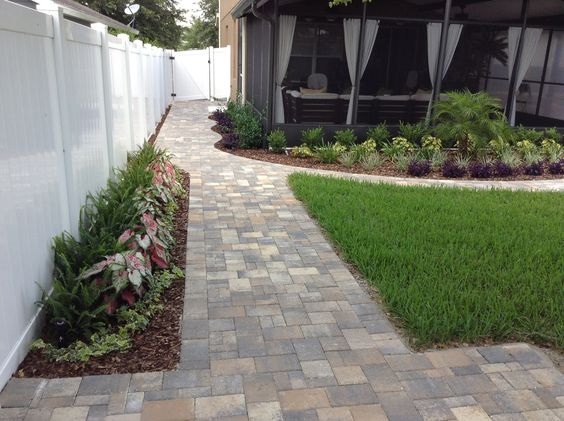 Improve your home's appearance with a durable concrete paver walkway.  http://abetterpaver.wordjack.com/
