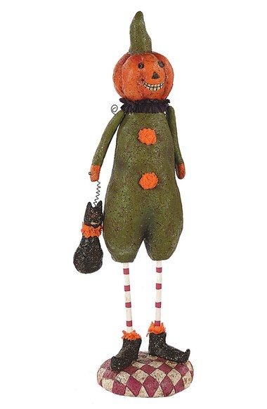 Up your home decor game this season with this adorable Halloween figurine!