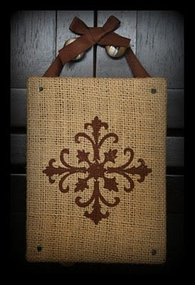 just hot glue burlap to a canvas and use a stamp or WHATEVER to make a design. hang on doorknob or drawer pulls. charming!