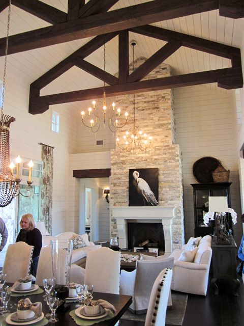 A two story limestone fireplace and dark brown trusses set for Austin stone fireplace