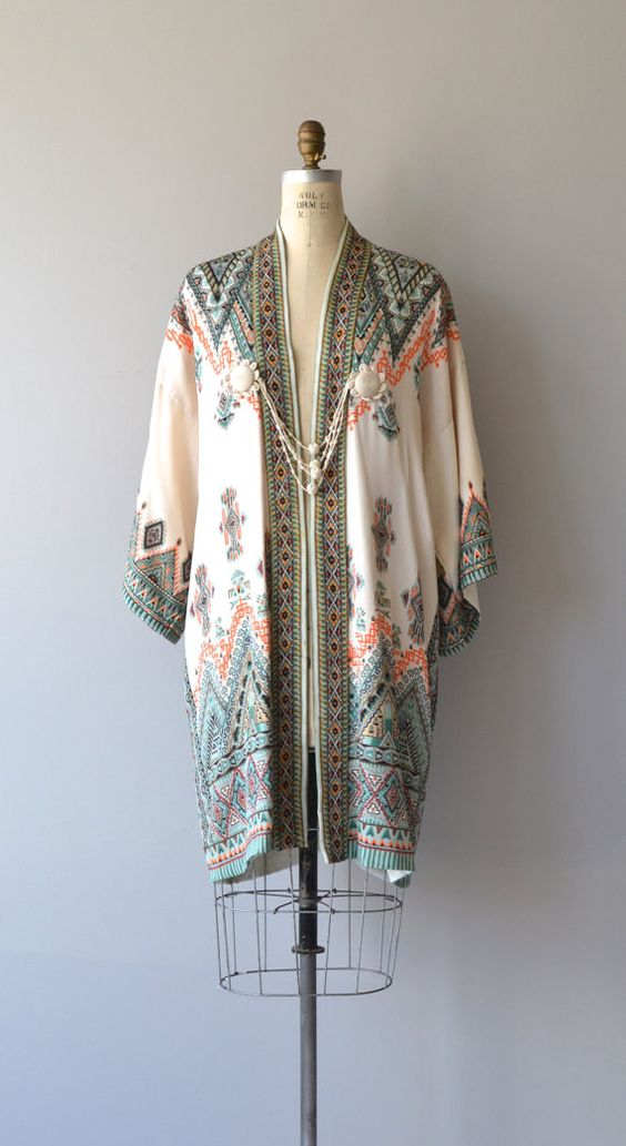1920s Japanese silk jacket with vibrant geometric pattern, kimono sleeves and exceptional silk corde tassel-type closure.