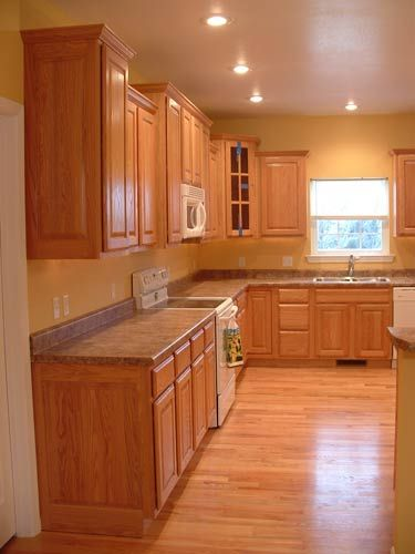 This Kitchen Has The Wood Floor And Cabinets Its Too Monochromatic For Me Is What I Worry About