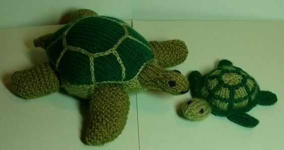 Knitted tortoise/turtles. Larger one is based on tortoise in Susie John's book 'Knitted Pets' , smaller one is based on the giant tortoise pattern in Sarah Keen's book  'Knitted Noah's Ark'