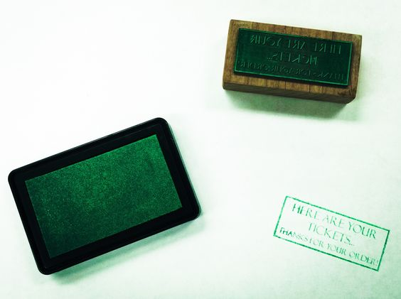Laser engraved rubber stamp with ink pad.