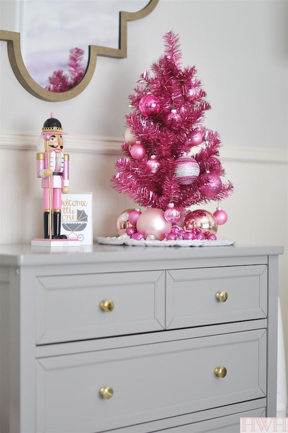 Festive holiday nursery with pink tinsel Christmas tree, ornaments and nutcracker | Honey We're Home