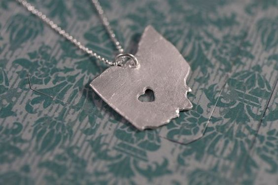 I want a charm bracelet or necklace like this with each state(with the heart) that we've lived in!