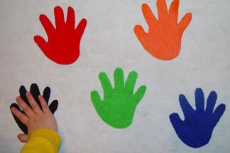 "Take your toddler's hand and draw an outline on some paper. Cut it out and use it as a pattern to cut out handprints in different colored felt. Now put the handprints all over the floor, couch, table and ask your toddler to find the ""green"" handprint and give it a hi-five! This is also a great activity for a group of toddlers!"