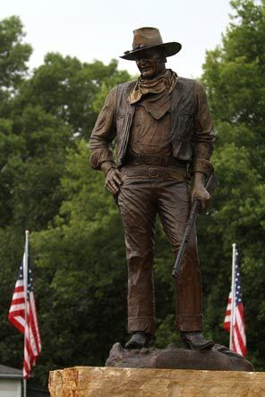 A statue of John Wayne, donated by his children, stands on the site in Winterset, Iowa, where a museum to the town's favorite son is planned.: