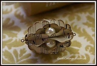 quillcottage.blogspot.com - elegant paper punch ornaments with tutorials