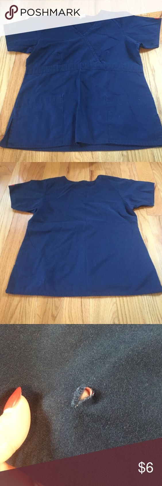 Navy scrub top Two front pockets; small hole on bottom of back (pic #3) but not very noticeable- other than that in great condition Dickies Tops