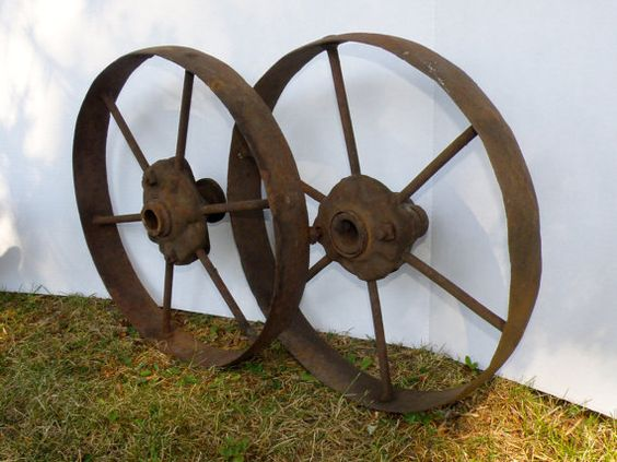 Set of Two Antique Cast Iron Wheels from a Farm Wagon or Implement