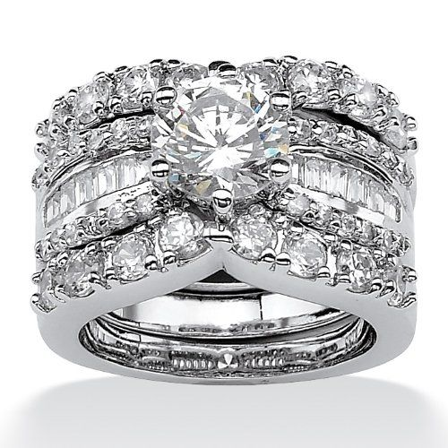 http://103rdavenue.com/palmbeach-jewelry-platinum-over-sterling-silver-diamonultratm-cubic-zirconia-wedding-ring-set/ Chic two-piece wedding ring set features a round and baguette DiamonUltra™ Cubic Zirconia design coveted by todays savvy brides, offering 4.20 carats T.W. set in superb platinum over sterling silver. Sizes 6-10.  (Carat weights may vary by plus or minus 5% of stated carat weight.) Palm Beach Jewelry Item #: 47624