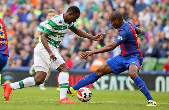 Celtic's French striker Moussa Dembele (L) vies with Barcelona's Brazilian defender Marlon (R) during the pre-season International…