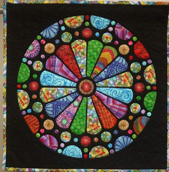 Stained glass rose window quilt.  Maker unknown.  2013 Ladies of the Lake quilt show, posted at Missouri Quilt Co Forum:
