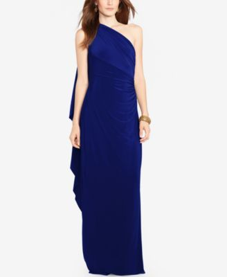 A beautiful cape flutters at the back of this Lauren Ralph Lauren jersey dress, accenting its one-shoulder silhouette. It's a stunning choice for a cocktail party or a formal dinner. | Polyester/elast