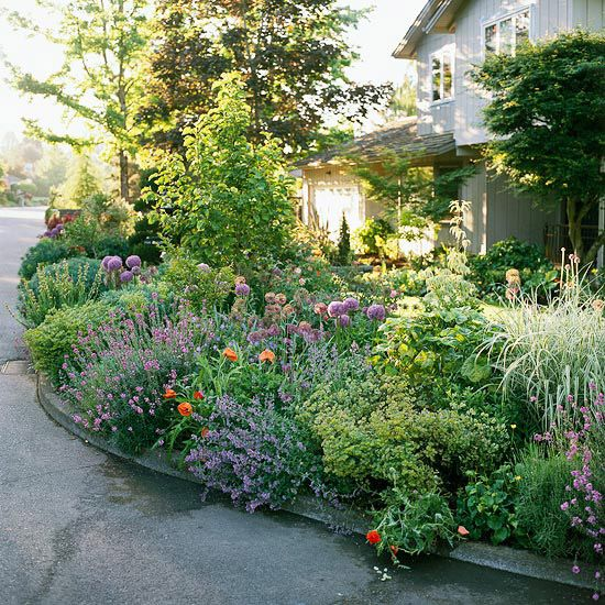 Street-side planting makes this yard feel larger. More landscape and gardening tips: http://www.bhg.com/gardening/landscaping-projects/landscape-basics/sidewalk-garden-front-yard/#page=6