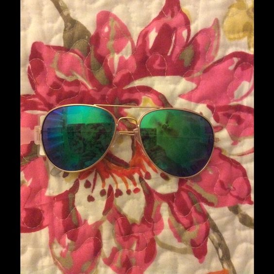 sunglasses never worn tag still on gold frames and bluegreen lenses