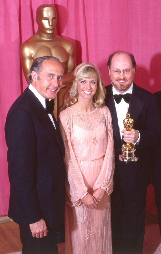 "John Williams - winner of the 1977 Best Score Academy Award for ""Star Wars"".  L to R: Henry Mancini, Olivia Newton-John, John Williams.  Williams won again for Best Score for ""Star Wars"" (1977)"
