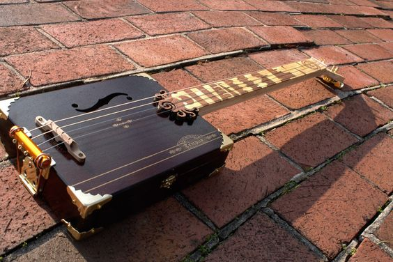String handmade acoustic cigar box guitar with exotic hardwood