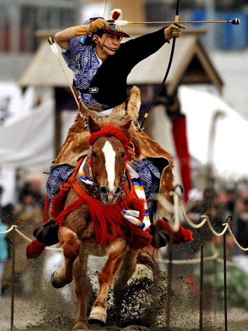 """Yabusame (流鏑馬) is a type of mounted archery in traditional Japanese archery. An archer on a running horse shoots three special """"turnip-headed"""" arrows successively at three wooden targets.  http://en.wikipedia.org/wiki/Yabusame"""