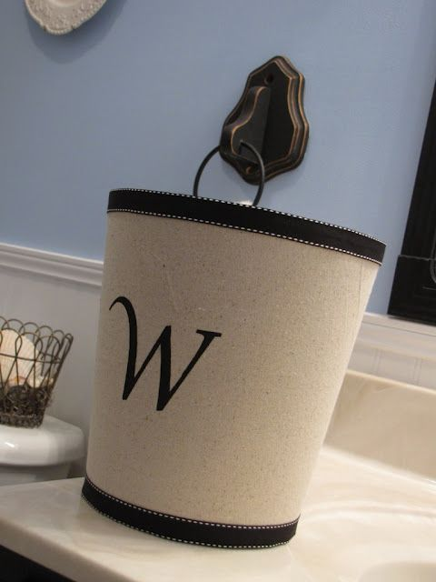 Fabric covered waste basket.  Simple and so much cuter!