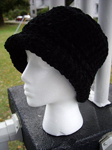 "Reversible Shape Hat - Cloche or Brimmed - Classic Black Chenille. A limited-edition reversible crocheted hat. Designed and handcrafted by me, made only of the finest fibers. You get two hats in one! When worn one way, it is a flat-topped, brimmed hat. Flip it inside out, and it is a cloche. Very cozy and stylish. It truly looks good on anybody, even those who are not ""hat people"". It is made of high quality, plush chenille yarn (acrylic/rayon blend). The color is black. The inside…"