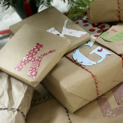 Wrapped presents with monograms made from gift wrap