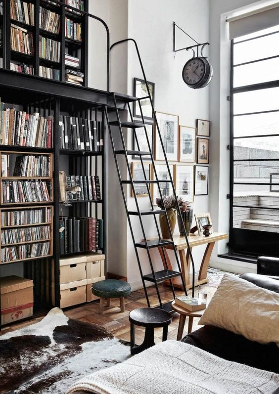 Loft living space with a built in library and cowhide rug