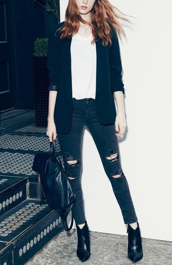 A boyfriend blazer paired with distressed skinny jeans, booties and a white-tee is a totally foolproof outfit for fall.