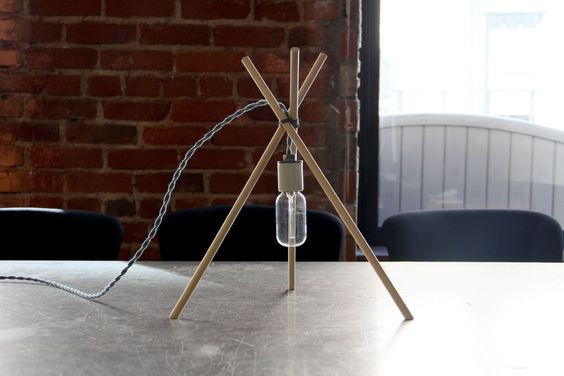 """Tres lamp by timwikander """"For my third project as an Instructables Artist in Residence, I set out to design a simple yet sturdy desk lamp that almost anyone could make.  Drawing inspiration from scrap project materials and Hoang M Nguyen's """"Lampfire"""", Tres Lamp is a customizable lamp that can be constructed with the most basic of tools."""""""