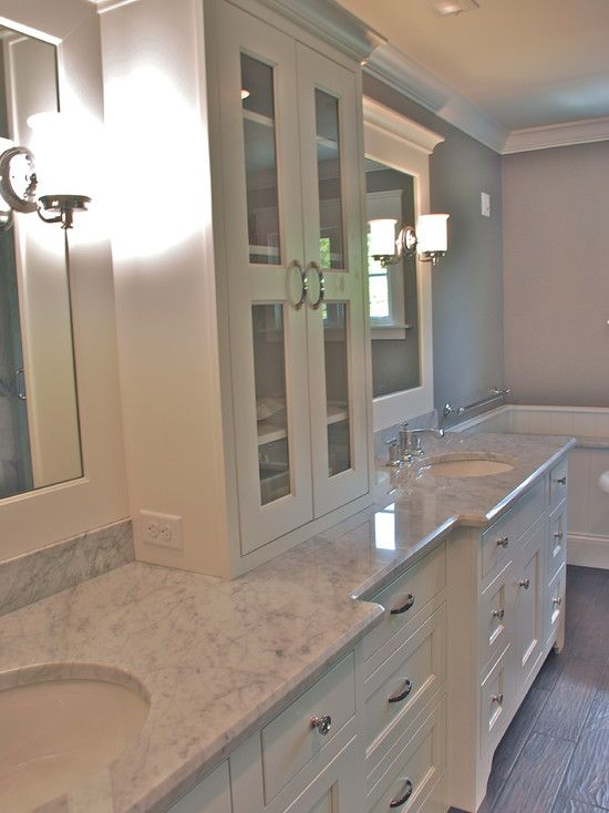 Love the center divide storage with glass doors and that for Master bathroom countertops
