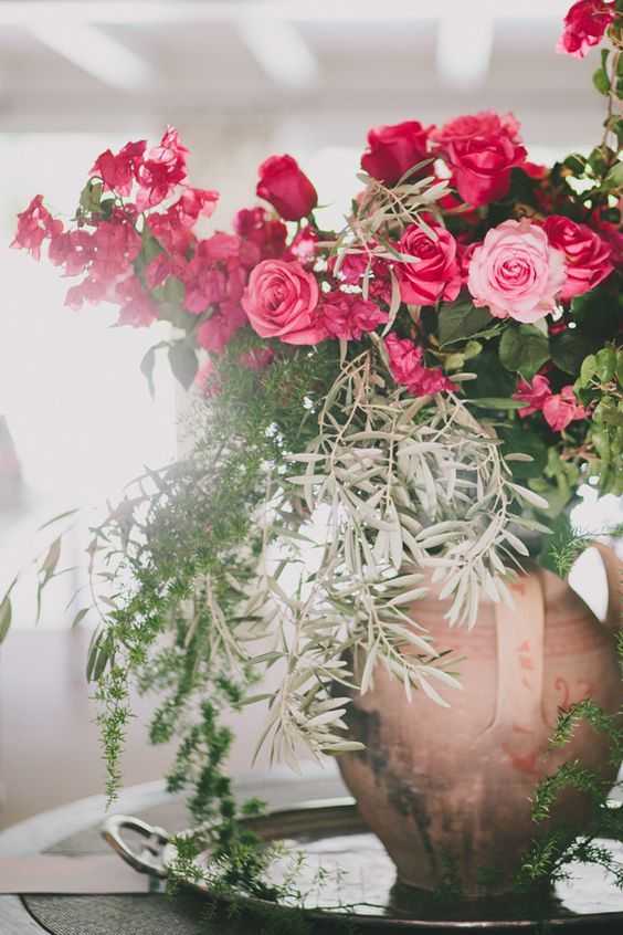 the most gorgeous centerpiece-- bougainvillea, pink roses and olive bough. moroccan palm springs wedding photography by fondly forever