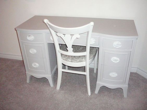 Lovely old desk, repainted and paired with Fleur de Lise style chair. Handles have same motif.