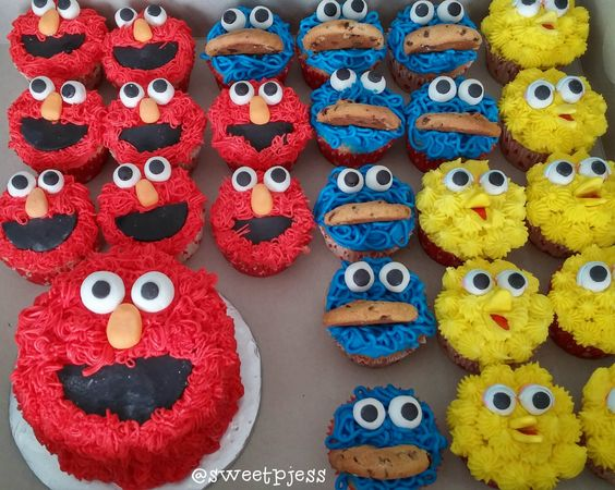 Elmo cake with elmo, cookie monster, and big bird cupcakes by @sweetpjess