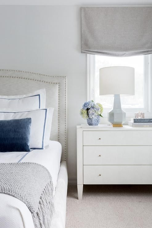 Transitional Bedroom Boasting A Light Gray Camelback Headboard With White And Blue Bedding Beside A Wh Camelback Headboard Blue Bedding White Bedroom Furniture