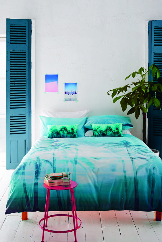 It's the design equivalent of dipping your toe into a crystal clear blue sea – splash bright, light blues and turquoises in every room of your home as well as feel-good holiday prints of tropical palm trees and fish.