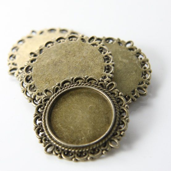 6pcs Antique Brass Tone Base Metal Findings-Cameo Setting 30mm (11859Y-F-115B). $2.75, via Etsy.