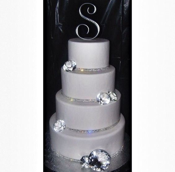 White diamond wedding cake with last initial topper