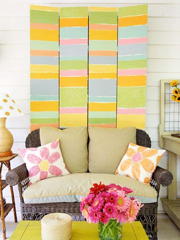 Sherbet striped bifold doors give this sun room a cheerful look.