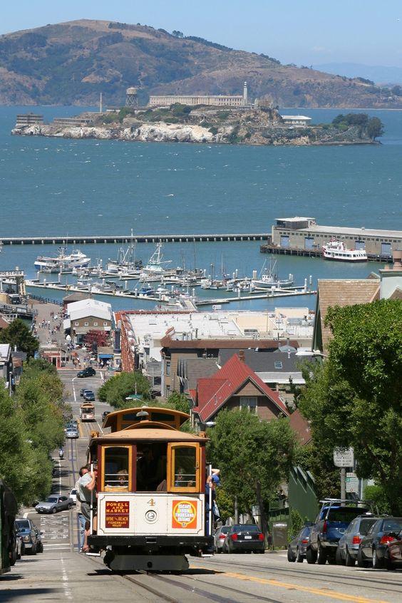 Cable car San Francisco with Alcatraz Island in the background, California, USA. #SanFrancisco