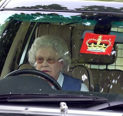 Queen Elizabeth with what I like to guess is the best parking sticker ever. I do believe she drives herself quite a bit - well done HM!!!